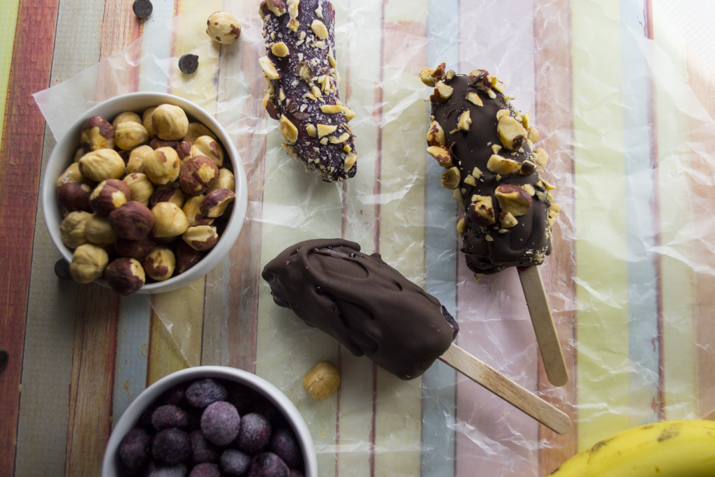 Kick your chocolate covered bananas up a notch with a layer of sweet blueberry! Add chopped hazelnuts and you've got a total winner. Try these today!