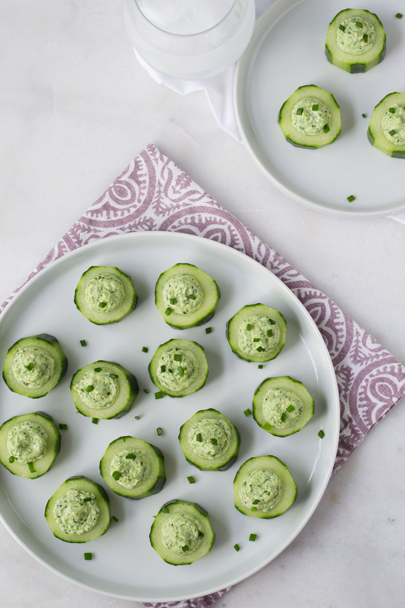 Easy no cook dinner party appetizer. Creamy tangy goat cheese with herbs in a cute cucumber cup.